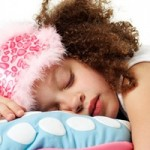 Young Girl Asleep on Pillow --- Image by © Royalty-Free/Corbis